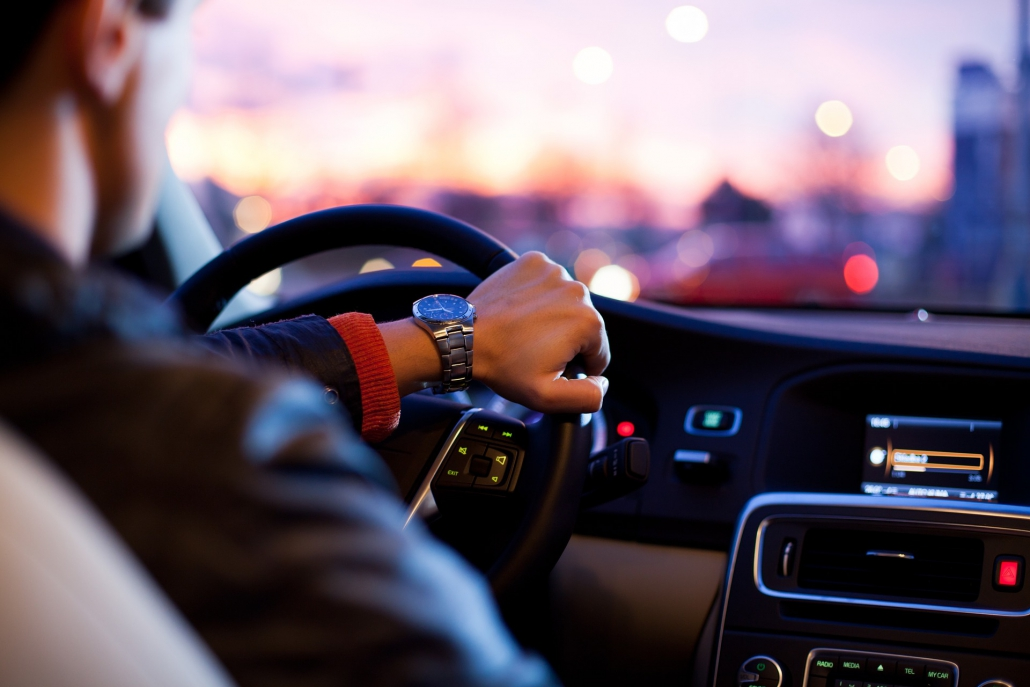 Man feels good driving after saving money on his car insurance in Florida