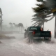 Man driving through hurricane in Tampa, Florida